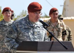 Sgt. Thomas Duval Maj. Gabe Simonds, commander for 1st Squadron, 112th Cavalry Regiment addresses an audience during a Transfer of Authority Ceremony held on the Multinational Force and Observer's South Camp in Sharm el-Sheikh, Egypt Feb. 19, 2015. The 1-112th Soldiers relinquished command of the U.S. Security Battalion to Soldiers from the 4th Squadron, 3rd Cavalry Regiment.