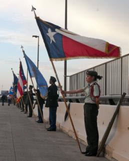 Sgt. Michael Vanpool Isela Flores, a senior at Martin High School in Laredo, Texas, holds the Texas state flag at parade rest during the International Bridge Ceremony in Laredo, Texas, Feb. 21. The ceremony commemorates the bonds between the United States and Mexico and features a series of abrazos, or embraces, between representatives of the two countries in the center of the bridge. (U.S. Army National Guard photo by Sgt. Michael Vanpool, 36th Infantry Division Public Affairs/Released)