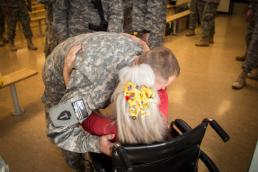 "Maj. Randall Stillinger A Soldier from the 1-112th Cavalry Regiment, 72nd Infantry Brigade Combat Team, receives a hug from Elizabeth Laird before boarding a plane at Robert Gray Army Airfield on Sep. 13, 2015. Laird is commonly known as ""The Hug Lady"" and is at Fort Hood for almost every arriving and departing flight. The 1-112th deployed to Egypt as part of the Multinational Force and Observers mission, which enforces the 1979 treaty between Israel and Egypt. (36th Infantry Division photo by Maj. Randy Stillinger)"