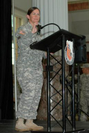 Sgt. Elizabeth Peña Warrant Officer Audrey M. Foushee speaks during the deployment ceremony for the Texas National Guard's 136th Expeditionary Signal Battalion, hosted by the Houston Astros, at Minute Maid Park in Houston, Texas, July 18, 2015. This marks the first time that the Texas National Guard has been supported by a Major League Association for a mobilization event. (Texas Army National Guard photo by Sgt. Elizabeth Pena/Released)
