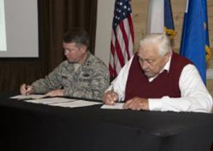 Capt. Martha Nigrelle Maj. Gen. John F. Nichols, adjutant general of Texas, left, and Charles Coleman, Thlopthlocco Tribal Town, right, sign letters of understanding during an annual tribal consultation conference to discuss the preservation and protection of historic resources located on Texas military lands, May 19-20, 2015, in Austin, Texas. The Texas Military Forces work one-on-one with tribes who trace their historic roots to Texas, for any period of time, in an effort to record both Texas military history and Texas tribal history for future generations. (Texas National Guard photo by Army Capt. Martha Nigrelle/Released)