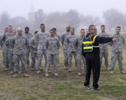 1st Lt. Alicia Lacy Staff Sgt. Anthony Delagarza, a Master Fitness Trainer Course instructor, gives directions to soldiers before a round of guerrilla drills March 3, 2015, at Fort Hood, Texas, as part of the Master Fitness Trainer Course. About 20 National Guard and active duty Army soldiers began the final two weeks of training to become master fitness trainers to act as special advisers to unit commanders to facilitate physical training. (Air National Guard photo by 1st Lt. Alicia M. Lacy/Released)
