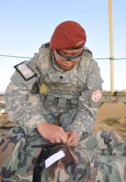Sgt. Thomas Duval Spc. Ricardo Gonzales, a combat medic from the Minnesota National Guard, currently serving in the Sinai Peninsula of Egypt with Task Force Sinai, performs first aid on a simulated casualty during the unit's Best Warrior Competition held March 18, 2015. During the competition Soldiers underwent a number of mental and physical tests that included trauma lanes, physical fitness test, weapons qualification and a formal board, among others. (U.S. Army Photo By: Sgt. Thomas Duval, Task Force Sinai Public Affairs)