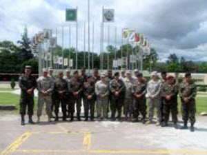Courtesy Photo  Members of the Texas Army National Guard's 72nd Brigade Special Troops Battalion stand with their Honduran and El Salvadoran counterparts following their four-month mentorship training program at the Honduran Army Signal School in Tegucigalpa, Honduras, July 1, 2015. The training, held May through September 2015, was part of the Regionally Aligned Forces' Counter Transnational Organized Crime (CTOC) partnership and featured Texas Guardsmen providing instruction on intelligence, reporting, and security operations. (Courtesy photo by Texas Army National Guard/Relesed)