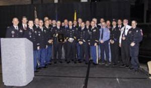 Courtesy Photo  Members of the Texas Military Forces' rescue air crews and Texas Task Force 1 receive the Higgins & Langley Memorial Award in Swiftwater Rescue during the 2015 Surface Water Rescue Conference in South Bend, Indiana, October 2, 2015. The award, presented collectively to the two rescue teams and their leadership, recognized their service during the May 2015 floods in central Texas. (Texas National Guard Photo by Texas State Guardsman Staff Sgt. Timothy Pruitt/Released)