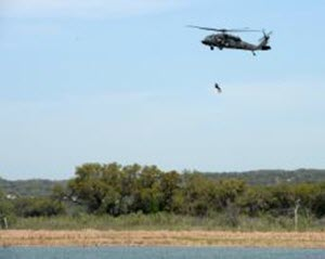 1st Lt. Alicia Lacy  A Texas Army National Guard Sikorsky UH-60 Black Hawk hoists a member from the Federal Emergency Management Agency's Texas Task Force 1 during a search and rescue exercise at Canyon Lake, Texas, April 11, 2014. The joint, interagency exercise simulated emergency response following a hurricane, with members from the Texas Air National Guard, Texas Army National Guard, Texas Task Force 1, the U.S. Coast Guard and Texas Department of Public Safety integrating to form a joint response team. (U.S. Air National Guard photo by 2nd Lt. Alicia Lacy/ Released)