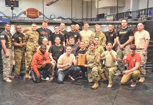 The 5th Engineer Battalion Combatives Team poses with the 2016 Commander's Cup Combatives Post Championship plaque at the conclusion of the finals at Davidson Fitness Center. The team earned 1,578 points over the three-day tournament.