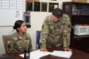 Courtesy Photo Master Sgt. Andrew Marmolejo , right, Texas Army National Guard, goes over administrative paperwork with one of the recruiters on his team. Marmolejo is the top recruiter for the Texas Army National Guard's Recruiting and Retention Battalion, a unit consistently meets and exceeds their recruiting goals. (U.S. Army National Guard photo by Mr. Steve Johnson/ Released)
