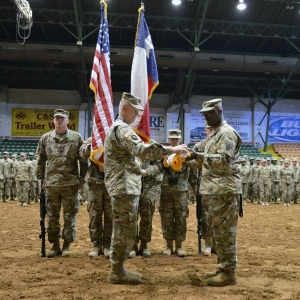 The 176th Engineer Brigade Commander, Colonel Charles M. Schoening and Command Sergeant Major Anthony Simms furl the brigade colors in preparation for deployment during the mobilization ceremony held for the brigade headquarters at Cowtown Coliseum in Fort Worth, Texas, June 4, 2016. The 176th Engineer Brigade headquarters boarded a flight in late July and set off on an historic mission to the Middle East to provide engineer support and capabilities to maneuver units across the U.S. Central Command area of responsibility. (Photo by U.S. National Guard Capt. Maria Mengrone)