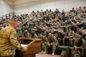 Photo By Adam Holguin | Soldiers assigned to the 389th Engineer Company and the 176th Engineer Brigade are led in prayer during the farewell brief at the Silas L. Copeland Airfield Control Group moments before boarding their flight to the Middle East July 29.