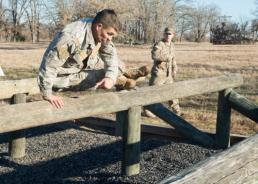 Senior Master Sgt. Elizabeth Gilbert Pfc. Marcial Ortiz, Chilean navy, competes in the obstacle course portion of the Texas Military Department's 2016 Best Warrior Competition at Camp Swift in Bastrop, Texas, Feb. 6, 2016. Traditionally a joint competition with competitors from the Texas Army and Air National Guards, this year's event invited service members from the U.S. Army Reserves component and the Chilean military to compete in the three-day grueling competition, testing the aptitude of each competitor in several mentally and physically challenging events relevant in today's operational environment. (U.S. Air National Guard photo by Senior Master Sgt. Elizabeth Gilbert/Released)