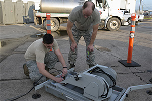 Left, Senior Airman Jeremy Vance, right, Tech Sgt. Christopher Dorriott, set up a mobile sattelite dish as part of the Texas Interoperability Communications Package, during a Hurricane evacuation exercise in the Lower Rio Grande Valley, June 7 -10, 2016. The TICP provides commincation capabilities for the command and control center during emergency disasters. (Photo by U.S. Army National Guard Sgt. Elizabeth Pena/Released)