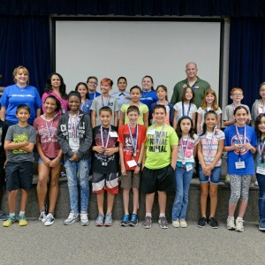 STARBASE Houston students pose with instructors and 147th Reconnaissance Wing Commander Col. Stan Jones at the end of the location's weeklong STEM camp at Ellington Field July 22, 2016. About 20 students attend the STEM camp. Starbase is a Department of Defense program to motivate students to explore science, technology, engineering, and math. (U.S. Air National Guard photo by 1st Lt. Alicia Lacy)
