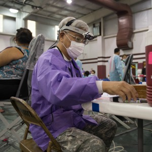 Lt. Col. John Hsu, a dentist in the 804th Medical Brigade, U.S. Army Reserves, Operations Chief for Dental Services, prepares to treat a patient at an Operation Lone Star site in Pharr, Texas, July 27, 2016. Service members from the Texas State Guard worked alongside Soldiers from the 804th Medical Brigade, U.S. Army Reserves, the Texas Department of Public Safety, the Department of State Health Services, Remote Area Medical volunteers, Cameron County Department of Health and Human Services (DHHS), City of Laredo Health Department, Hidalgo County DHHS and U.S. Public Health Services during Operation Lone Star (OLS), a week long real-time, large-scale emergency preparedness exercise in La Joya, Pharr, Brownsville, Rio Grande City and Laredo, Texas, July 25-29, 2016. OLS is an annual medical disaster preparedness training exercise, uniting federal, state and local health and human service providers, that addresses the medical needs of thousands of underserved Texas residents every year. (U.S. Army National Guard photo by Sgt. 1st Class Malcolm McClendon)