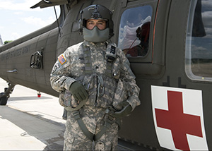 Texas Army National Guard Sgt. Joseph A. Fuentes, a crew chief with the 2-149th General Support Aviation Battalion, of the 36 Infantry Division, based out of San Antonio, Texas, stands ready for the next medevac emergency June 4, 2016. The State Operations Center requested more resources from the Texas Military Department due to the recent flooding across Texas. The 2-149th is equipped with medevac capabilities such as aircraft, to transport litter and ambulatory patients to a higher level of care. (Photo by: U.S. Army National Guard Sgt. Elizabeth Pena)