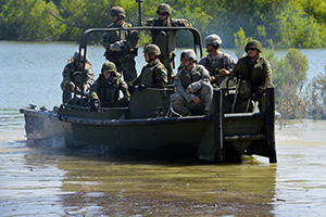 Service members from the Texas National Guard's 386th Engineer Battalion, the 551st Multi Role Bridge Company, U.S. Army's 20th Engineer Battalion, and the Czech Republic 15th Engineer Regiment conduct a wet gap crossing during a operation rehearsal June 20, 2016, at Fort Hood, Texas, as part of a Multinational Lumberjack River Exercise. Through the States' Partnership Program, the Texas Army National Guard currently works alongside the Czech Republic and Chile to conduct military operations in support of defense security goals. (U.S. Army National Guard photo by Sgt. Elizabeth Pena/Released)