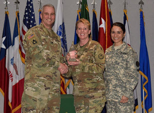 Courtesy Photo | Army Maj. Gen. Richard Gallant, Special Assistant to the Director of the Army National Guard, (left) presents Army Brig. Gen. Tracy Norris, Assistant Deputy Adjutant General of the Texas National Guard (center) and SFC Brenda Lopez, TXARNG G5 NCOIC (right), with the Army National Guard Communities of Excellence third place in the Bronze division at a ceremony held at the Army National Guard Readiness Center in Arlington, Virginia, May 23, 2016. (U.S. Army National Guard photo by Staff Sgt. Michelle Gonzalez)