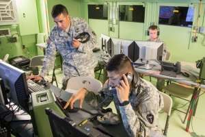 Photo By Maj. Randall Stillinger | Sgt. 1st Class Juan Martinez, the Tactical Action Center Non-Commissioned Officer In Charge and Pvt. Gerardo Romano, a truck driver with 36th Inf. Div., monitor the communications systems at the Tactical Action Center during the Multi-Echelon Integrated Brigade Training exercise at Fort Hood, Texas. Communications Soldiers provided equipment and support for the higher headquarters division staff which communicated with several Active and reserve component units. (U.S. Army photo by Maj. Randall Stillinger, 36th Infantry Division Public Affairs)