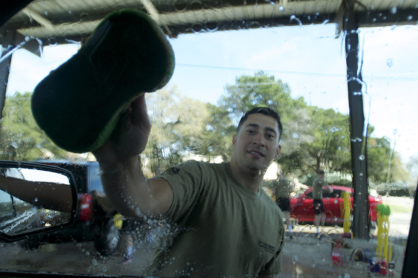 Members of Warrant Officer Candidate School Course 16-01 host a car wash at Camp Mabry in Austin, Texas, March 5, 2016, to raise funds for their graduation ceremony. The candidates are in Phase II of the three-part course that will turn them into technical experts in their fields within the United States Army. (U.S. Army National Guard photo by Pvt. Kourtney Grimes/Released)