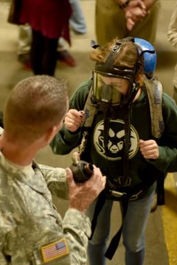 Master Sgt. Daniel Griego Students from the Hill Country Christian School of Austin visit the Texas National Guard's 6th Civil Support Team at Camp Mabry in Austin, Texas, March 24, 2016. The field trip showed the students practical applications of chemistry in the real world and allowed them the opportunity to try on specialized hazardous materials suits. (U.S. Army National Guard photo by 1st Sgt. Daniel Griego)