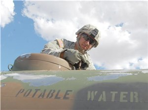 Guardsmen for 3rd battalion, 133 Field Artillery regiment use water buffalos to deliver drinking water to more than 1,400 correctional officers, staff and inmate at the Rogelio Sanchez State Jail in El Paso, Texas, Aug. 11, 2016.   After a main water break at the jail, administrators reached out to the unit to provide potable water to the site until water was restored to the facility.