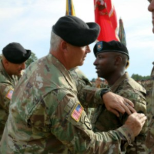 (Photo by Staff Sgt. Nathan Akridge) Command Sgt. Maj. Ronald Bly, senior enlisted adviser for 3rd Brigade Combat Team, 10th Mountain Division (LI), places the 36th Infantry Division patch on a battalion command sergeant major during a ceremony Friday at Fort Polk, La. The 3rd Brigade Combat Team is the first active-duty brigade to wear a National Guard unit's patch and is currently the only active Army unit wearing a National Guard patch.