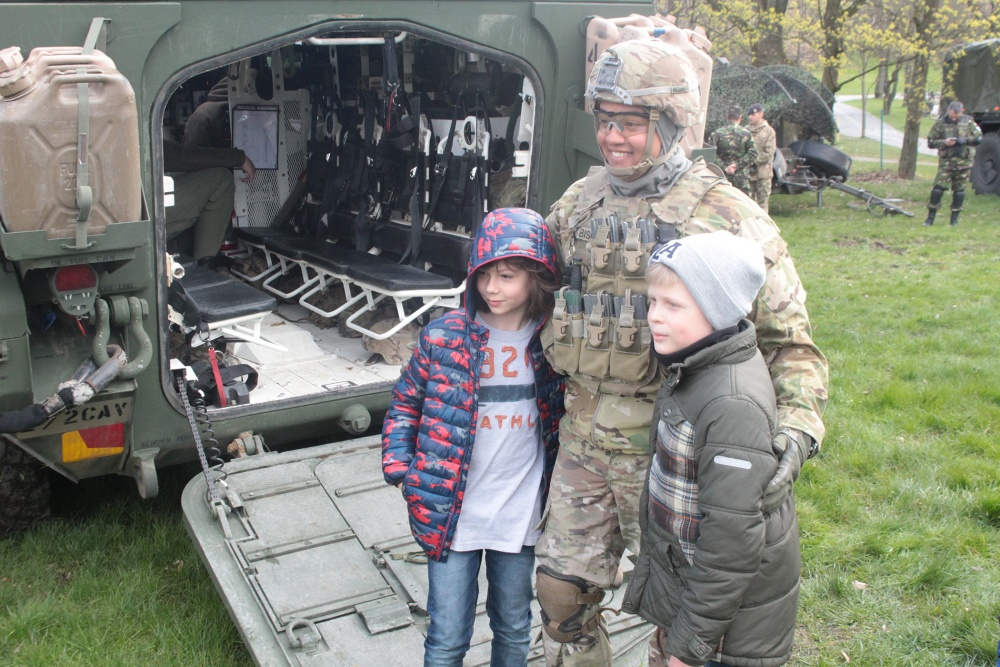 Courtesy Photo | A Battle Group Poland U.S. Soldier poses with local children, on the ramp of a Stryker during a static display at a military academy in Elk, Poland, April 22. Families came by to see the NATO equipment and meet the soldiers in person. The unique formation comprised of U.S., U.K., Romanian and Polish soldiers, will serve as a deterrence force in northeast Poland in support of NATO's Enhanced Forward Presence. (U.S. Army photo by Pfc. Brandon Shiplett/Released)