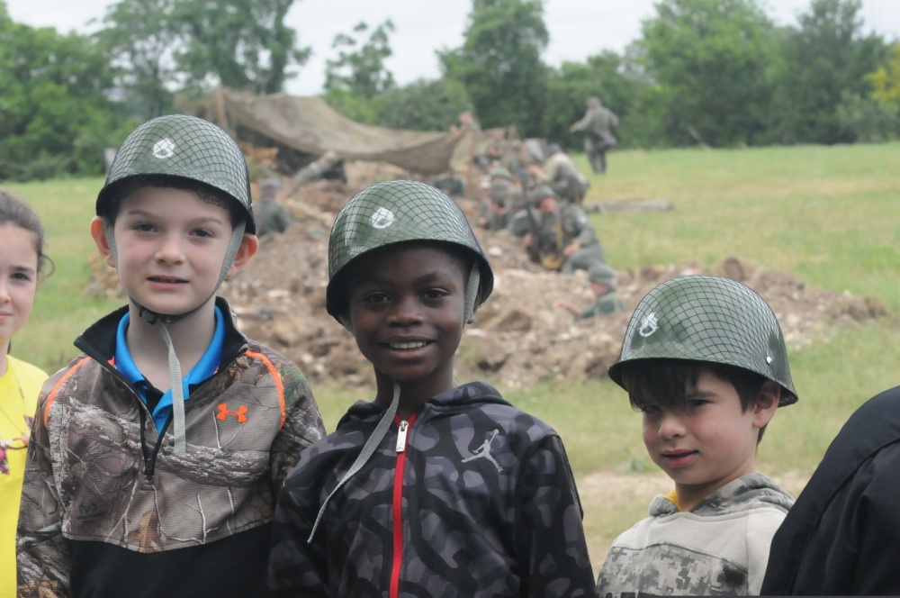 Photo By Sgt. Mark Otte | Kids watch WWII re-enactment at Texas Military Department Open House And American Heroes Air Show at Camp Mabry. (U.S. Army photo by Sgt Mark Otte, 100th Mobile Public Affairs Detachment)