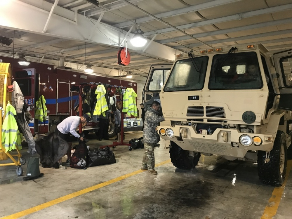 Photo By Capt. Martha Nigrelle | Texas Guardsmen from the 386th Engineer Battalion partnered with first responders from Texas Task Force One and the Cypress Creek Fire Department move residents from severely flooded neighborhoods to safety days after Hurricane Harvey hit south Texas, August 28, 2017, Cypress Creek, Texas. The team of Soldiers, Firefighters and rescue swimmers, paired with local volunteers and rescued more than 1,000 people and hundreds of dogs and cats, bringing them to dry ground. (U.S. Army National Guard photo by Capt. Martha Nigrelle)