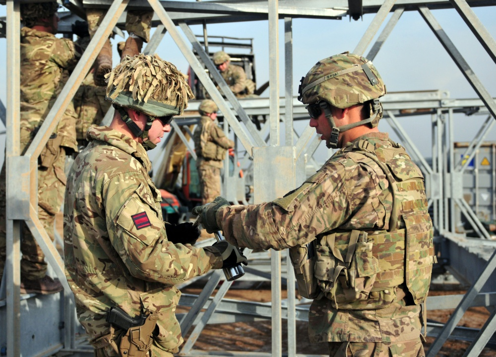 Soldiers from the 310th Multi-Role Bridge Company work alongside engineers from the British Army to dismantle an Acrow bridge they built together. The Acrow bridge built helped hone the skills of U.S. and British engineers in preparation to train Iraqi Army bridge engineers at Camp Taji, Iraq, Jan. 31, 2017. The 310th MRBC is assigned to the 153rd Engineer Battalion, 176th Engineer Brigade (Task Force Chaos). (U.S. Army National Guard photo by Capt. Maria Mengrone/Released)