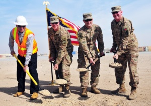 Photo By Capt. Maria Mengrone | On Feb. 14, 2017, Camp Buerhing officials broke ground on the $3.7 million Essayons Village complex which will include a series of buildings for future engineer brigades and battalions supporting operations in the Middle East. Pictured (left to right) Mr. Raymond Soto, Program Operations Senior Director for Vectrus and resident of New York City, N.Y., Lt. Col. Carl W. Aufdenkampe, Director of DPW-North and hails from Fort Huachuca, Ariz., Lt. Col. Christopher M. Leung, Camp Commander of Camp Buerhing and resident of Champaign, Ill., and Chaplain (Lt. Col.) Maurice D. Millican, representing Soldiers of the 176th Engineer Brigade (Task Force Chaos) and resident of Harker Heights, Texas. (U.S. Army National Guard photo by Capt. Maria Mengrone/Released)