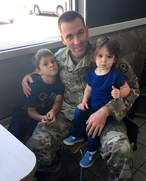 Texas Army National Guard Staff Sgt. Aaron Dias, recruiting and retention officer for the Recruiting and Retention Battalion, Region II, Team VII, enjoys lunch with his six-year-old son Gavin, left, and 18-month-old Aeryn, right, at a local resturant Nov. 12, 2016, in Tyler, Texas. Dias is responsible for rendering aid and saving the life a blind pedestrian that was struck by a vehicle in East Texas. (U.S. Army National Guard photo by Sgt. Elizabeth Pena)