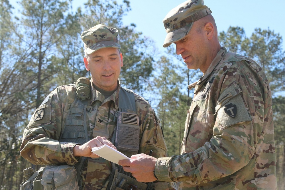 Photo By Staff Sgt. Nathan Akridge | Col. Clarence Henderson Jr. (left) commander of the 72nd Infantry Brigade Combat Team, 36th Infantry Division and Col. Brian Sullivan (right) commander of the 3rd Brigade Combat Team, 10th Mountain Division discuss lessons learned while conducting a joint training exercise.