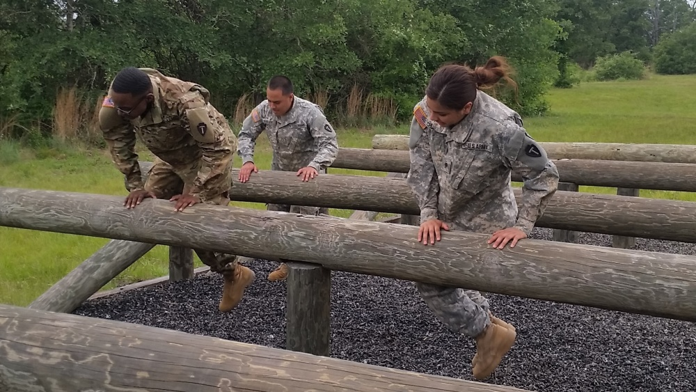 Soldiers of 72nd Infantry Brigade Combat Team, 36th Infantry Division navigate through obstacle course in an event to promote Sexual Harassment Assault Response Prevention awareness on Apr. 22, 2017 at Camp Swift, Texas. (U.S. Army Photo by Capt. James Greenwood, 72nd IBCT Public Affairs)