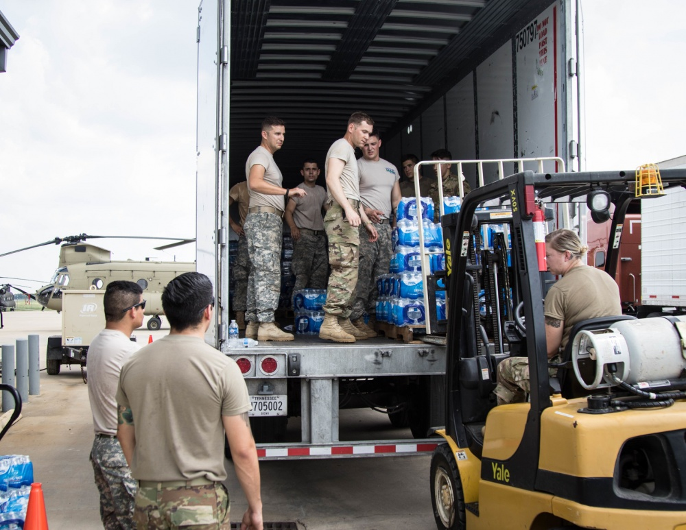 Photo By Sgt. Jazmin Jenkins | Soldiers from the 36th Combat Aviation Brigade unload pallets of water from a Federal Emergency Management Agency (FEMA) semi-truck at Houston Exective Airport in Katy, Texas to be distributed to Hurricane Harvey victims Sept. 3, 2017. The Department of Defense is conducting Defense Support of Civil Authorities operations in response to the effects of Hurricane Harvey. DSCA operations are part of the DOD's response capability to assist civilian responders in saving lives, relieving human suffering and mitigating property damage in response to a catastrophic disaster. (U.S. Army photo by: Sgt. Jazmin Jenkins / 22nd Mobile Public Affairs Detachment)