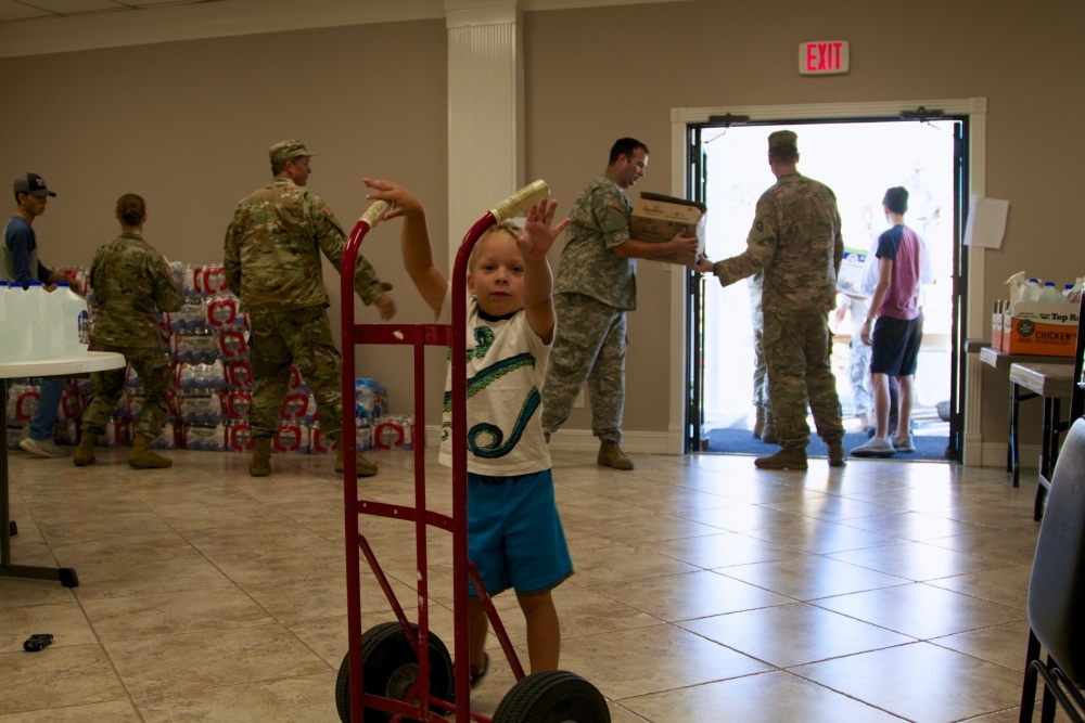 Photo By Sgt. Matthew Wright | Soldiers from 36 ID help Chaplain Brian K. Hudson offload supplies to First Church of Orange, Texas on Thursday Sep. 7, 2017 as a coordinated effort to get much needed provisions to the local communities.