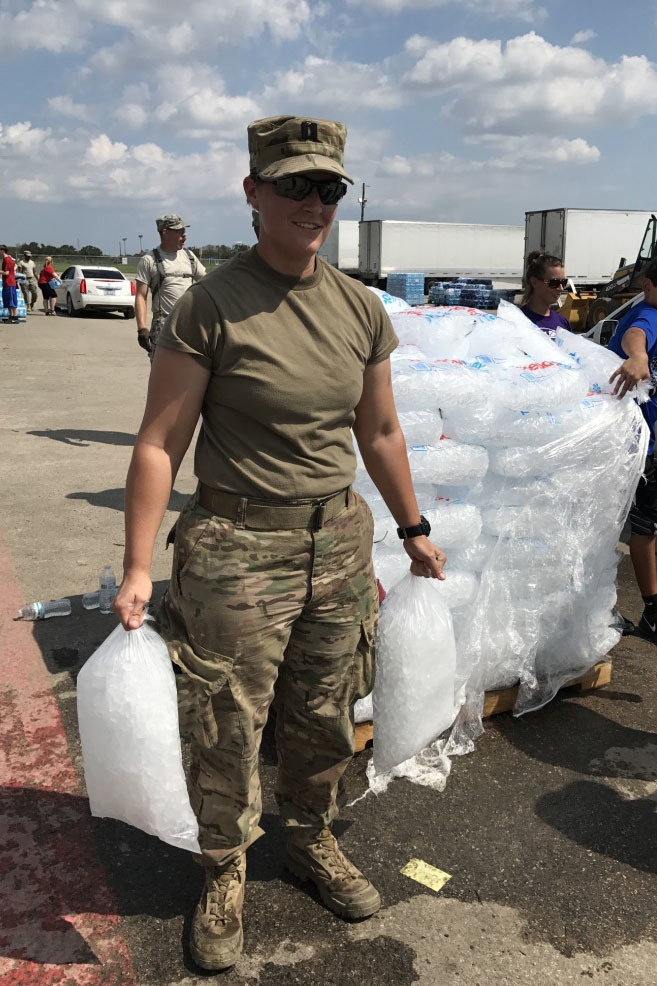 Photo By Capt. Martha Nigrelle | Texas Army National Guard, Capt. Amber Luecke, 71st enhanced Military Intelligence Brigade, mans the ice point at a the Point of Distribution (POD) where locals received clean water, ice and food in Victoria, Texas, Sept. 2, 2017. Texas Guardsmen set up numerous PODs in areas like Victoria, to ensure residents maintained access to clean water, as they worked to recover from the effects of the hurricane. (U.S. Army National Guard photo by Capt. Martha Nigrelle)