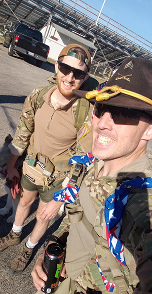 "Sgt. Magby and Cpl. Garrett Thompson completing the ""42 in 24"" Ruck March in support of the Texas Airborne Alliance. (Courtesy Photo: Sgt. Benjamin Magby)"