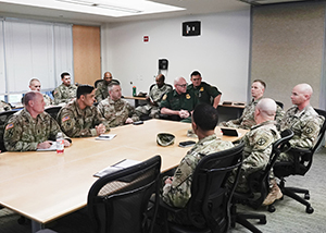 National Guardsmen and U.S. Border Patrol Agents discuss the transfer of authority responsibilities at the U.S. Border Patrol Rio Grande Valley Sector Headquarters, Edinburg, Texas, Nov. 1, 2019. (Air National Guard photo by Staff Sgt. De'Jon Williams)