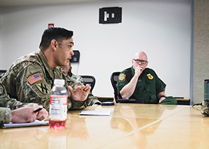 Georgia Army National Guard Capt. Guy Serapion briefs National Guard and U.S. Border Patrol members at the U.S. Border Patrol Rio Grande Valley Sector Headquarters, Edinburg, Texas, Nov. 1, 2019. (Air National Guard photo by Staff Sgt. De'Jon Williams)