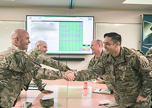 U.S. Army Lt. Col. Brian Tritten shakes hands with Georgia Army National Guard Capt. Guy Serapion at the U.S. Border Patrol Rio Grande Valley Sector Headquarters, Edinburg, Texas, Nov. 1, 2019. (Air National Guard photo by Staff Sgt. De'Jon Williams)