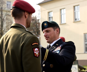 A Texas Guardsman assigned to the Army's 19th Special Forces Group (Airborne), presents a U.S. Army Combat Infantryman Badge to a Czech Republic Special Forces soldier during a during a ceremony in Prostejov, Oct. 25, 2019.