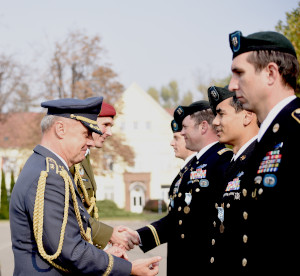 Czech Republic Air Force Maj. Gen. Jiri Verner, Deputy Chief of the General Staff of Czech Armed Forces Command, presents the Medal of the Minister of Defense of Czech Republic to Texas Guardsmen assigned to the Army's 19th Special Forces Group (Airborne), during a ceremony in Prostejov, Oct. 25, 2019, hosted by their State Partner, Czech Republic. (U.S. Army photo by Staff Sgt. Elizabeth Pena)