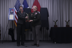 Mrs. Timmy L. Hines receives an award from Maj. Gen. Tracy Norris on behalf of retired Col. Timmy L. Hines at the Texas Military Department's Hall of Honor induction ceremony at Camp Mabry October 27, 2019. Hines, a Vietnam War veteran, served more than 33 years in the military. Hines also championed equality throughout his career, recruiting the Texas National Guard's first female aviator and promoted the growth of female aviators at the 149th Aviation Brigade's flight school. (U.S. Army photo by Spc. Miguel Ruiz)