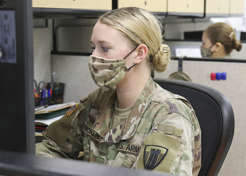 "Army National Guard Pfc. Tori Stricklin, a human resource specialist with the 176th Engineer Brigade, updates the Joint Task Force 176 personnel status roster at Camp Mabry in Austin, Texas, April 17, 2020. Pfc. Stricklin is one of several service members who normally serve on a part-time basis, but were activated to full-time duty after the COVID-19 pandemic impacted their full-time employment. ""In the chaos caused by this pandemic, some Texans are struggling to stay employed, and that includes many National Guard Soldiers,"" said Col. Robert Crockem commander of Joint Task Force 176. ""By activating unemployed Guardsmen to full-time status, we seized another opportunity to help Texans thrive."" (U.S. Army National Guard photo by Staff Sgt. Michael Giles, 36th Infantry Division Public Affairs)"