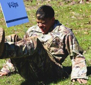 Army Pfc. Maximilliano Estrada of the 71st Expeditionary Military Intelligence Brigade performs V-ups during the obstacle course portion of the Texas Military Department's 2020 Best Warrior Competition March 5, 2020 at Camp Swift near Bastrop, Texas. Estrada, who began bleeding half-way through the event, refused to stop and completed the course.