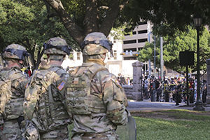Texas Army National Guard Soldiers attached to Joint Task Force 176's Task Force Capitol support law enforcement during protests at the Texas State Capitol in Austin, Texas, June 19, 2020. On May 30, 2020, Governor Greg Abbott activated elements of the Texas Military Department to ensure safety for Texans during the protests that followed the death of George Floyd. (U.S. Army National Guard photo by Staff Sgt. Michael Giles, 36th Infantry Division Public Affairs)