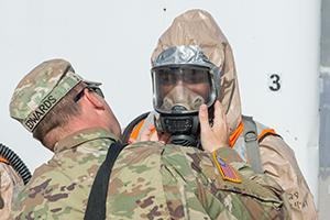 ROUND ROCK, Texas Dec 5, 2019 — National Guardsmen from the Texas based 136th Infintray Division, CBRNE Task Force, check resperators before preforming decontamination drill as part of a FEMA certification. These drills are an important preperation for disasters that may occurn in FEMA region 6. (U.S. Army Photo by Andrew R. Smith/Released)