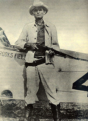 Brigadier General William Sterlinlg posing with a rifle at Brooks Field, a former U.S. Army airfield located outside of San Antonio, Texas. Members of the Texas National Guard participated in pilot training for both fixed wing aircraft and blimps in the 1930's.