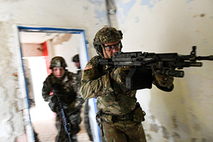 Spc. Jerrad Nicholson, with the Indiana Army National Guard's 1st Squadron, 152nd Cavalry Regiment, leads Soldiers into a room during Slovak Shield 2019, a training exercise in Lešt, Slovakia, Nov. 10, 2019, as part of the Defense Department's State Partnership Program. (U.S. Air Force Photo by Senior Airman Jonathan Padish)